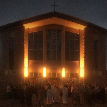 St. Bridget Northside Minneapolis - lighting of the candle ceremony during Easter Vigil 2015
